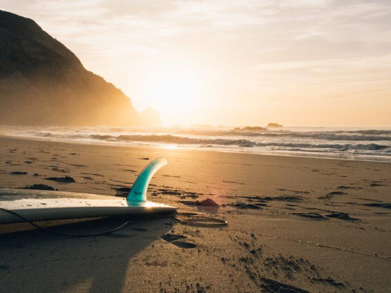 a surfboard on the beach