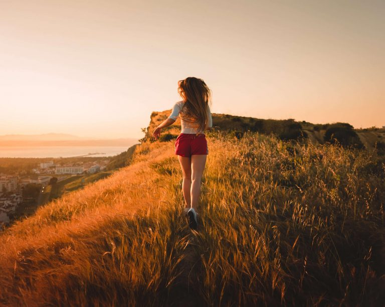 A woman is running on the hill